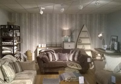 Feature wallpapered wall in retail unit