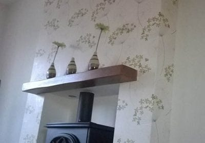 Wallpapered chimney breast professionally hung