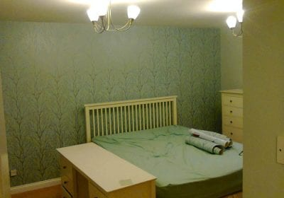 Bedroom feature wallpapered wall