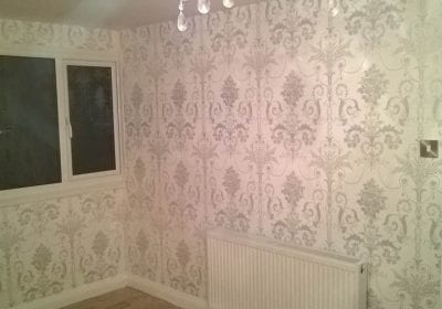 White silver wallpaper hung professionally