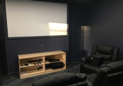 Painted cinema room in office block