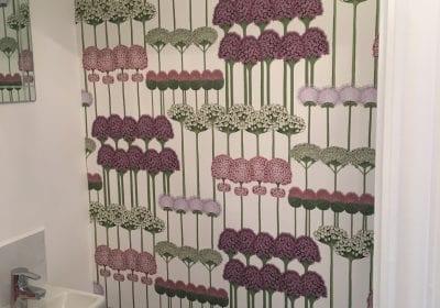 Wallpapered wall bathroom