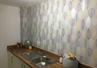 Wallpapered utility room