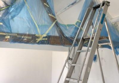 Professional painting protecting beams