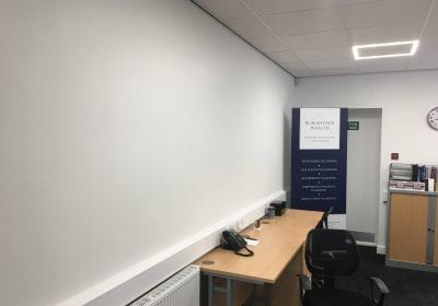Commercial office walls painted with airless sprayers