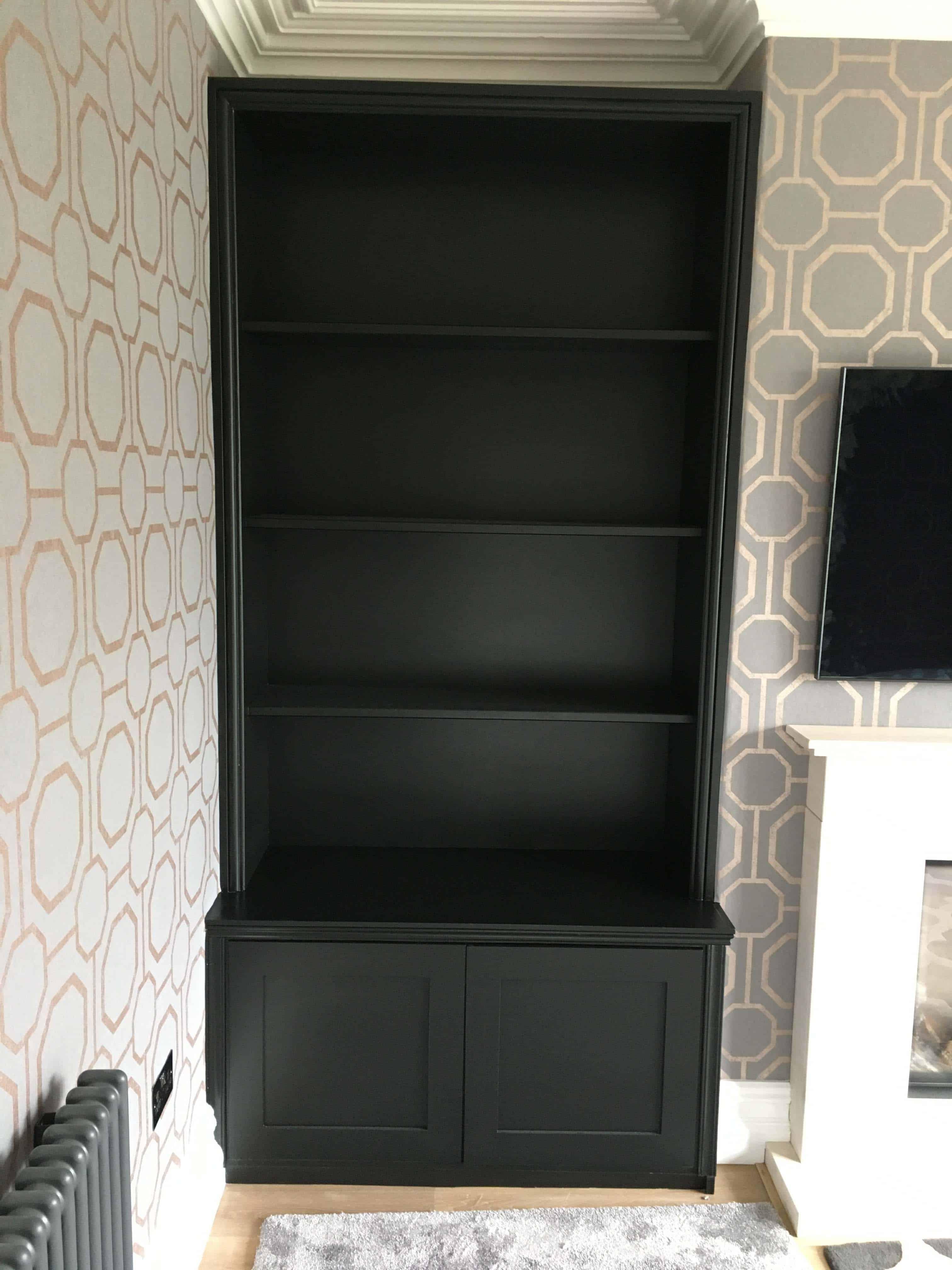 Black sprayed bookcase in black